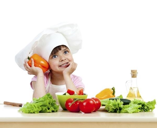 Chef girl preparing healthy food vegetable salad over white back