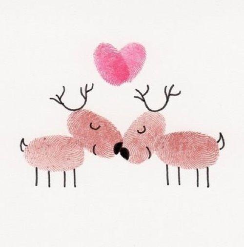 Amorosos renos de Navidad con pintura de dedos