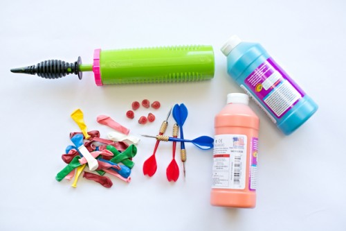 globos pintura dardos materiales